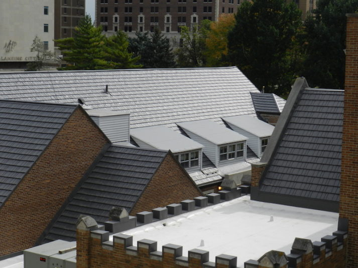 Sloping roofs with one white flat roof portion
